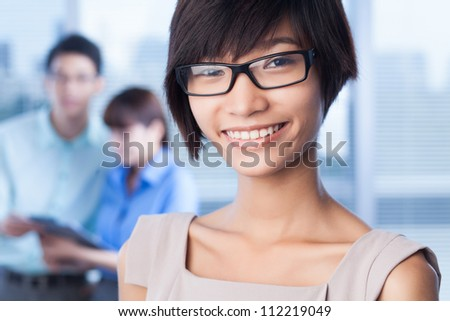 Cheerful young lady making her career in business - stock photo