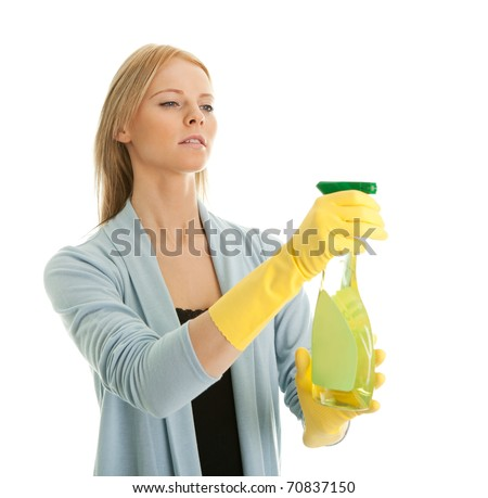 Cheerful young lady spraying cleaner liquid