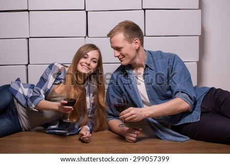 Cheerful young marriage toasting for move out - stock photo