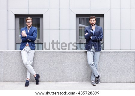 Cheerful young men are making serious decision - stock photo
