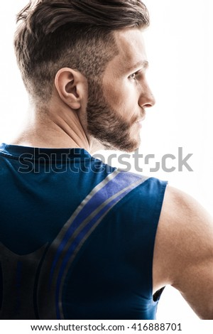 Cheerful young sportsman is expressing his masculinity - stock photo