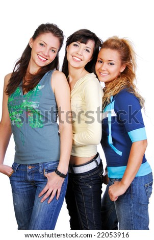Cheerful young three attractive girls. Studio shot on white - stock photo