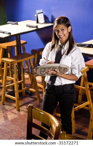 Cheerful young waitress - stock photo