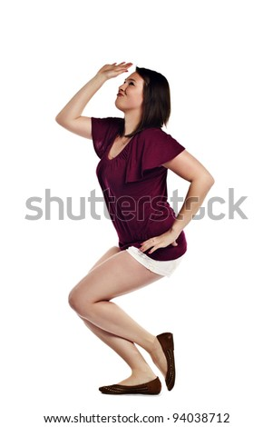 Cheerful young woman doing funny dance isolated on white background