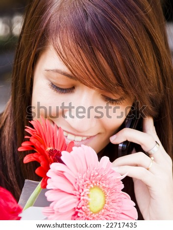 Cheerful young woman having a sweet tome at phone. - stock photo