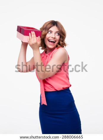 Cheerful young woman holding gift isolated on a white background - stock photo