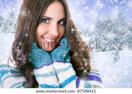 cheerful young woman in winter sweater, isolated on white background
