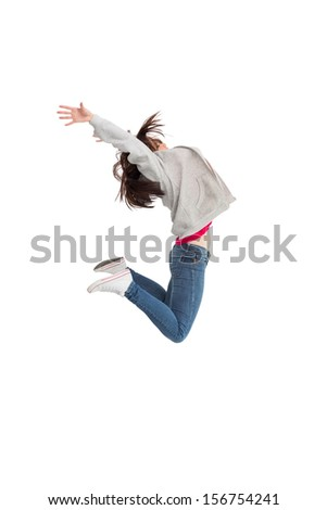 Cheerful young woman jumping on white background - stock photo
