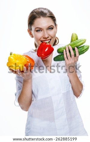 Cheerful young woman of the European appearance promotes a healthy lifestyle by eating health food / photoset of brunette girl wearing white shirt - isolated on white background   - stock photo