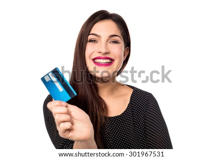 Cheerful young woman showing her credit card - stock photo