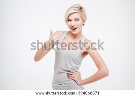 Cheerful young woman showing thumb up isolated on a white background - stock photo
