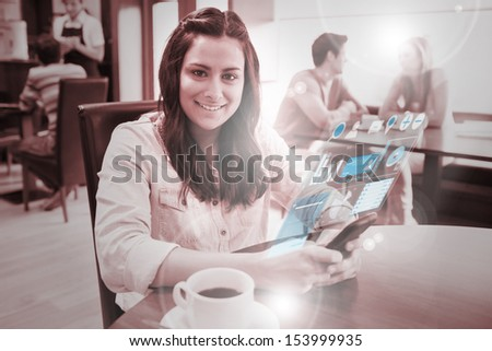 Cheerful young woman studying on futuristic smartphone in bright cafe - stock photo