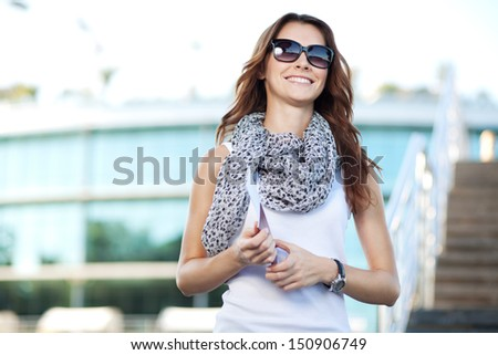 cheerful young woman tourist holding passport and pass ticket - stock photo