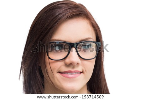 Cheerful young woman wearing glasses posing on white background