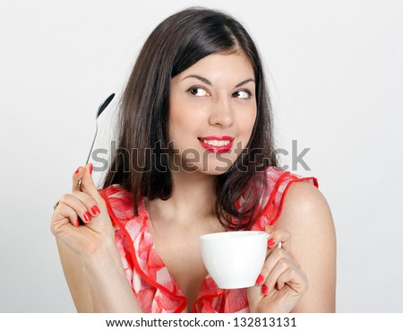 Cheerful young woman with a cup of coffee on a white background. - stock photo