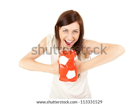 cheerful young woman with ball, white background - stock photo