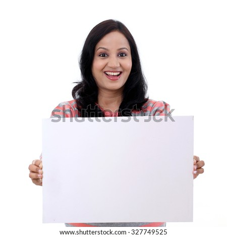 Cheerful young woman with blank white board  - stock photo