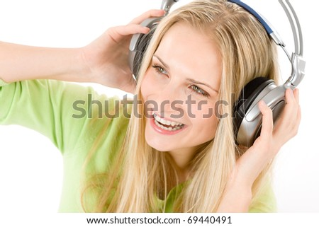 Cheerful young woman with headphones listen to music