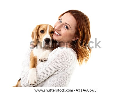 Cheerful young woman with her pretty dog - stock photo