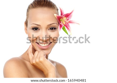 Cheerful young woman with pink lily flower