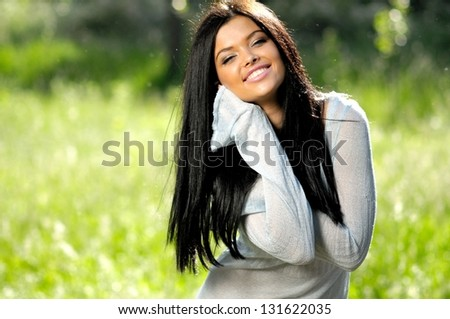 Cheerful young women on green with poplar down - stock photo
