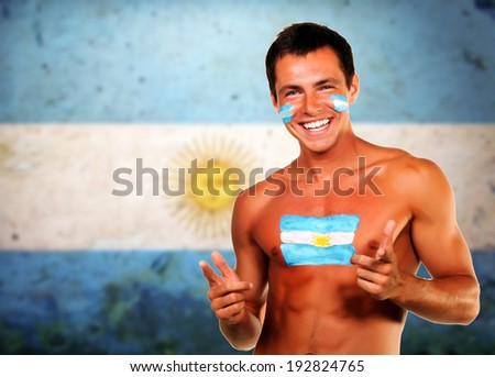 Cheering argentinian soccer fan over argentina flag background - stock photo