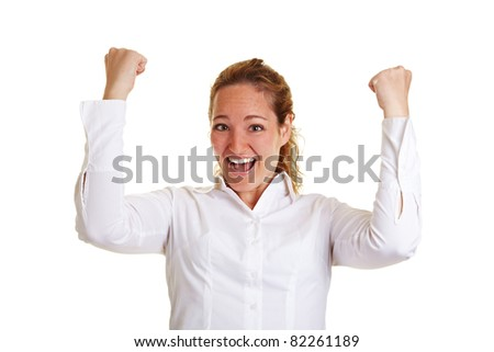 Cheering business woman with clenched fists - stock photo