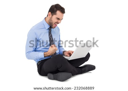 Cheering businessman sitting using his laptop on white background