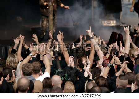 cheering crowd at a rock concert - stock photo