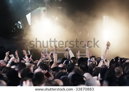 Cheering crowd at a rock-concert - stock photo