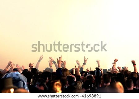 cheering crowd at concert - stock photo