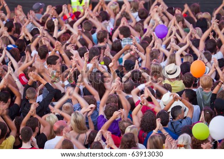 cheering crowd happy clapping their hands - stock photo