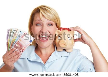 Cheering female winner with Euro money bills and piggy bank - stock photo