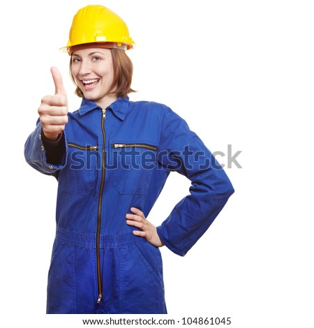 Cheering female worker in boiler suit showing thumbs up - stock photo