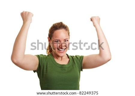 Cheering happy woman clenching both her fists - stock photo