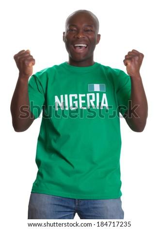 Cheering sports fan from Nigeria - stock photo