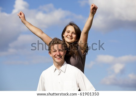 cheering teenage couple - stock photo