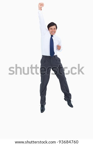 Cheering tradesman with raised arm against a white background
