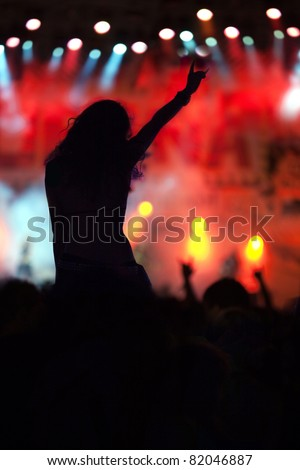 cheering woman crowd at concert - stock photo