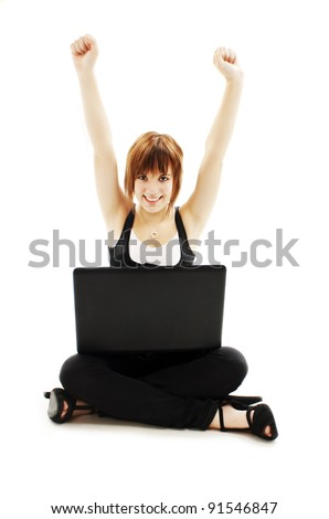 Cheering young woman sitting cross-legged while surfing the internet. All on white background. - stock photo