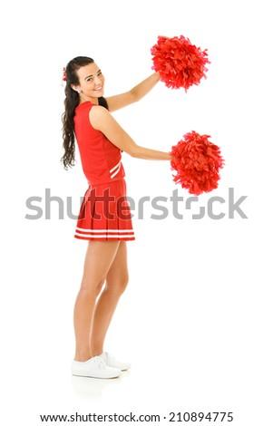 Cheerleader: Cute Cheerleader With Poms Gestures To Side - stock photo
