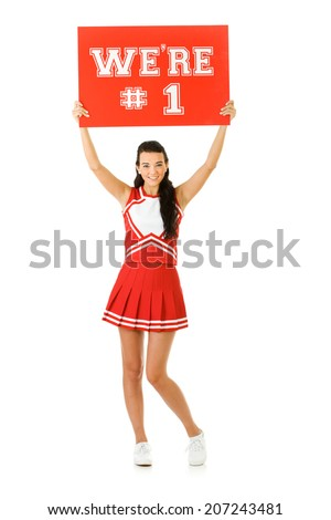 "Cheerleader: Girl Holding Up Sign Saying ""We're #1"" - stock photo"