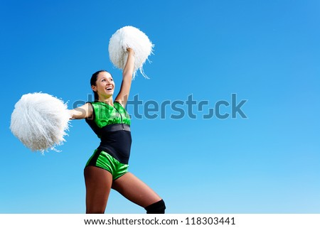 cheerleader girl on a background of blue sky