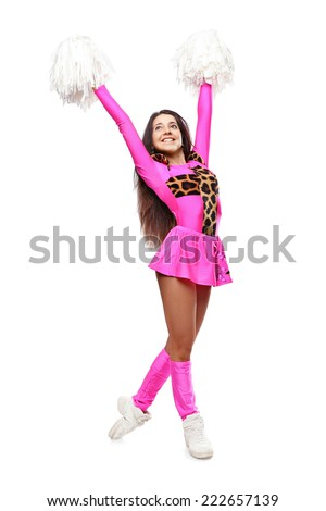 Cheerleader girl pose standing with pom-pom. Pretty flexible girl pink leo costume