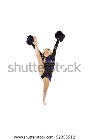 Cheerleader kicking one leg into the air with her arms up holding pom poms
