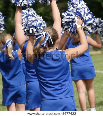 Cheerleaders Cheering at Football Game - stock photo