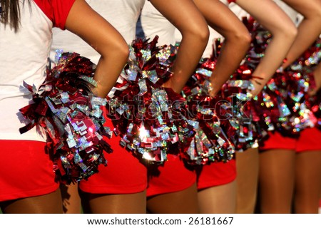 cheerleaders closeup in a symmetrical formation - stock photo