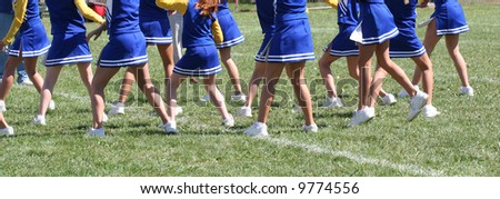 Cheerleaders in Line at Game on field - stock photo