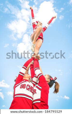 Cheerleaders team during Competition outdoors - stock photo
