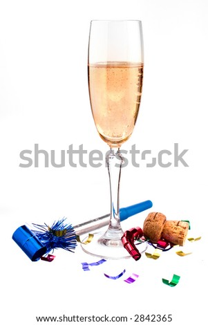 cheers! champagne in a flute on white ground with noisemaker, ribbon confetti and cork. - stock photo
